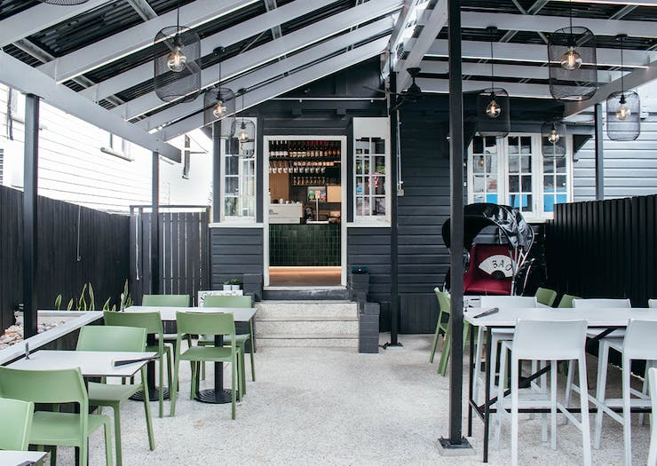 outdoor terrace at Baos Pop, with door leading inside at the back