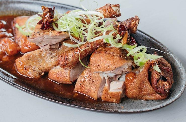 a plate of crispy golden duck