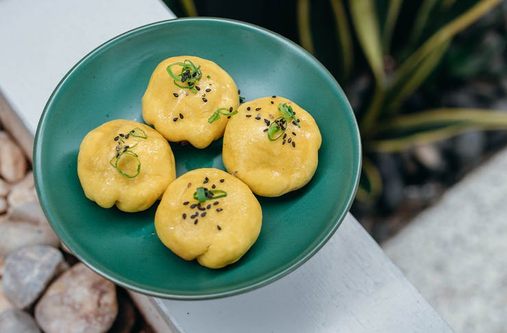 a plate of yellow dumplings