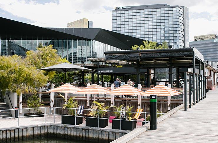 An open-air bar by the Yarra River.