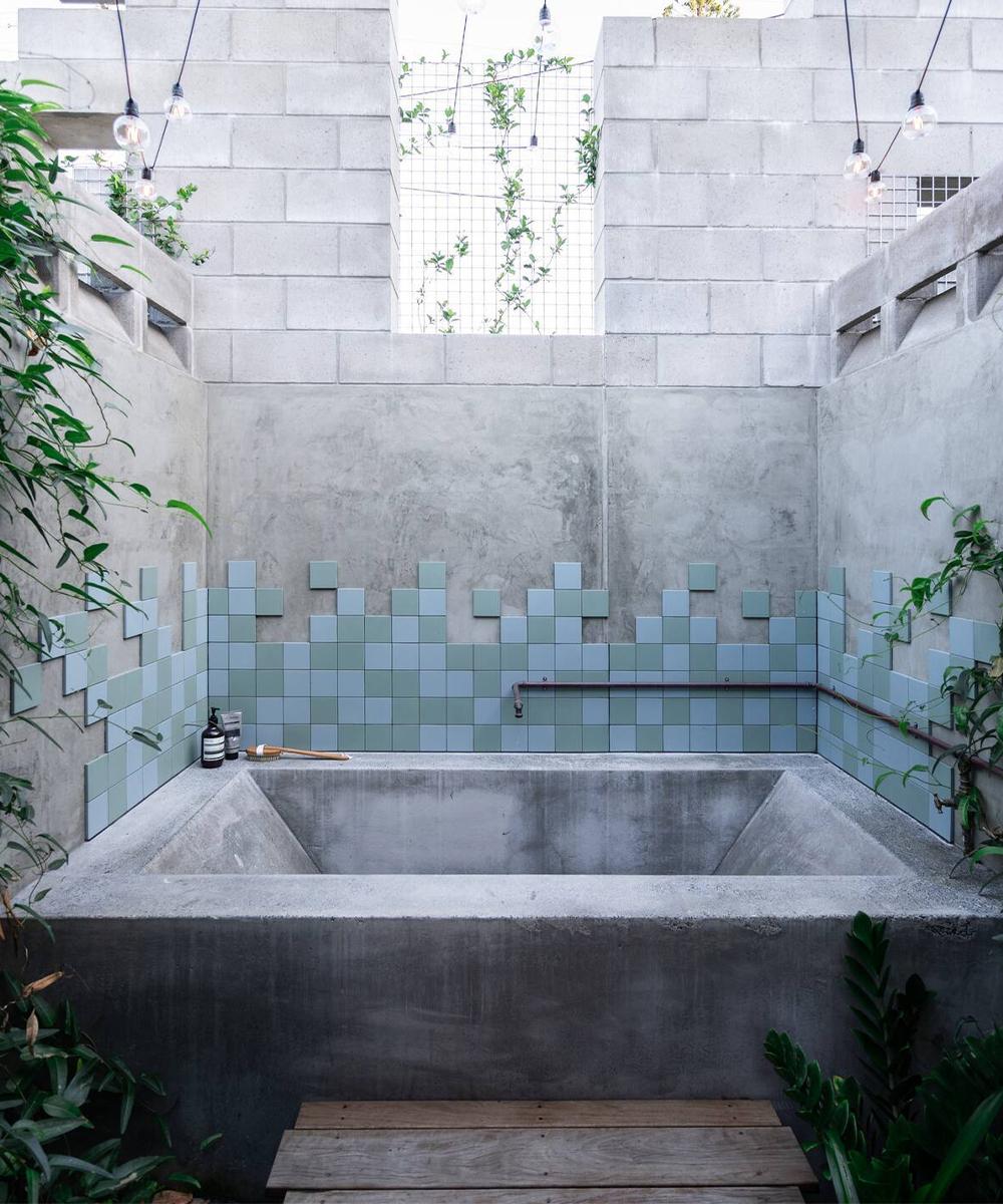 a stone bath out in a courtyard