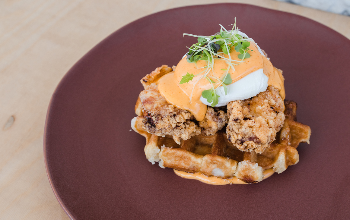 fried chicken eggs benny on a waffle