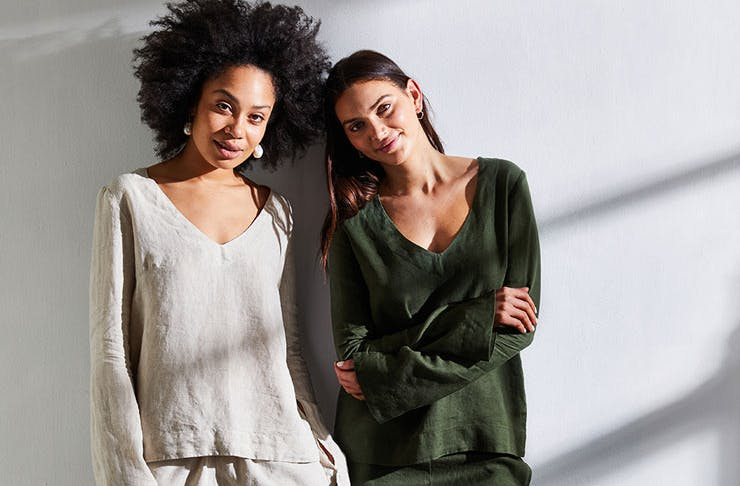 Two models wear Bed Threads' sleepwear in ivory and olive colours.