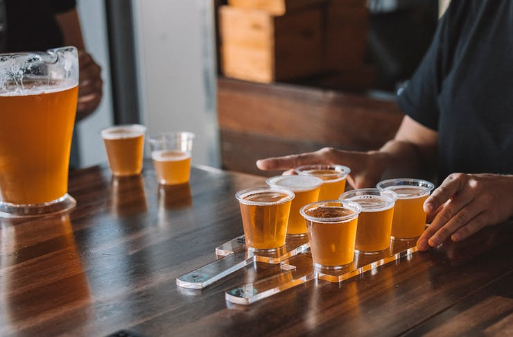 a beer paddle on a bar