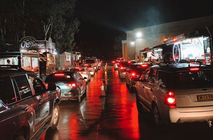 Cars queueing on a rainy evening at Bella Vista Hotel's innovative food truck drive thru.