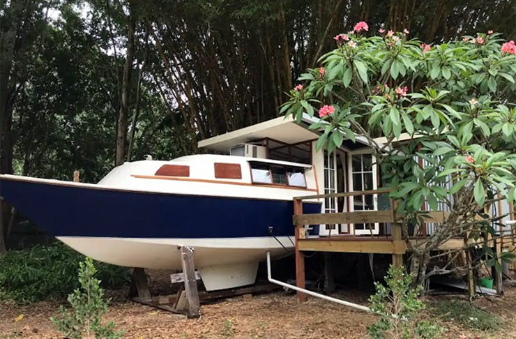 a tiny landlocked boathouse