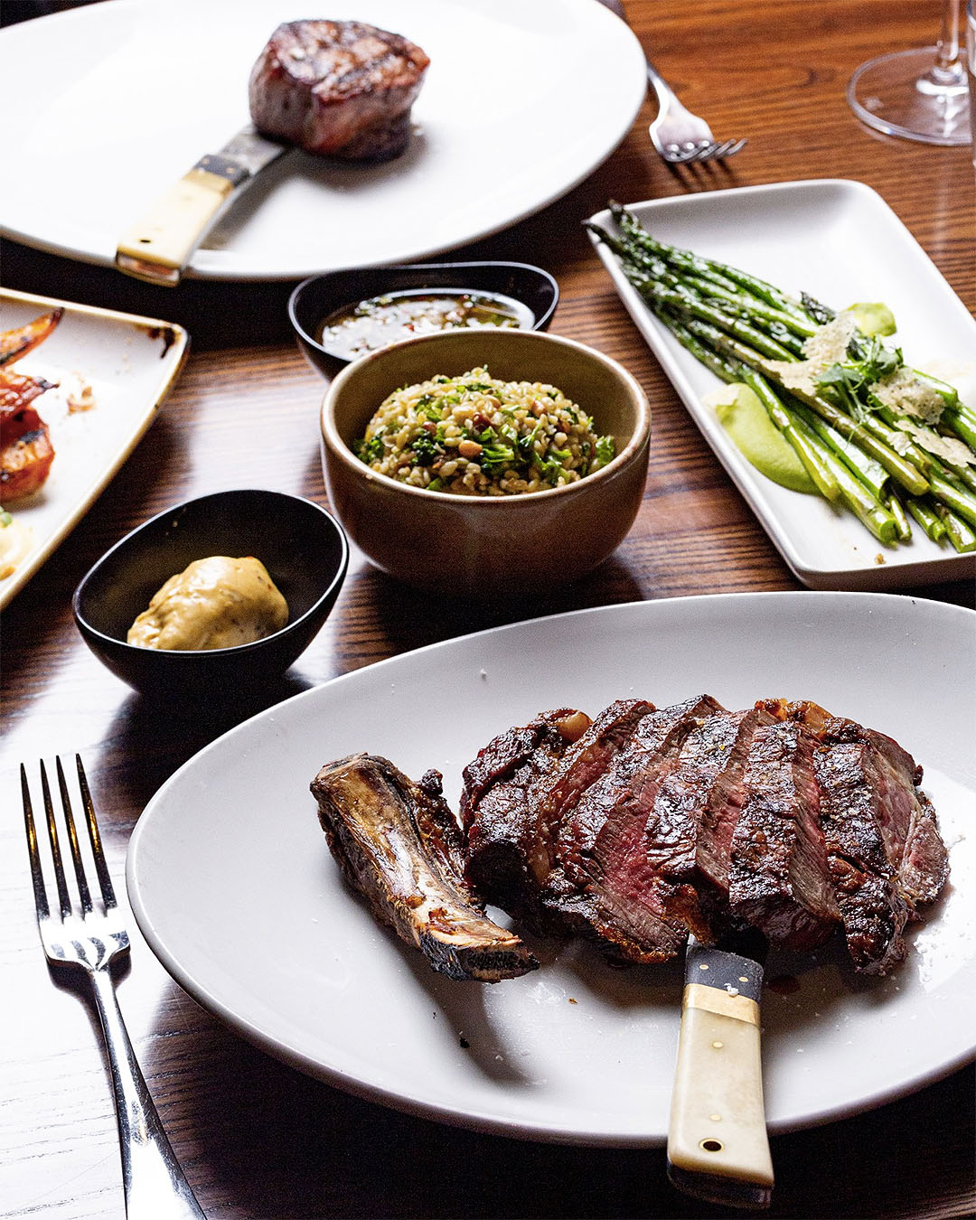 A good looking steak with various sides laid out on the table at Bessie, one of Christchurch's best restaurants.