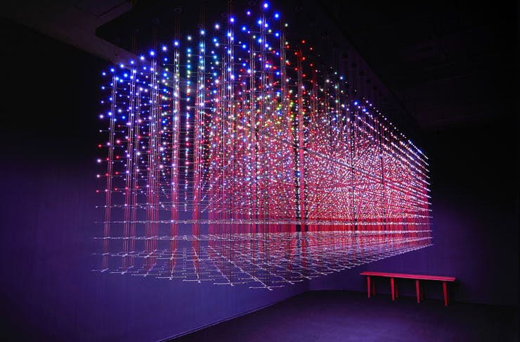 A luminous artwork featuring laser-like lights in a grid pattern at White Rabbit Gallery in Syd.