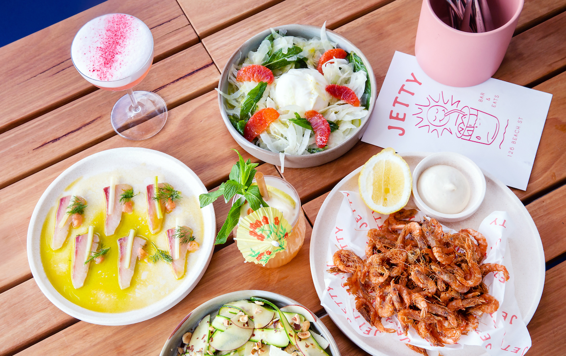 a table filled with shared plates and cocktails from Jetty bar And Eats in Fremantle