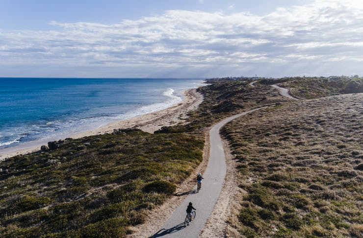 two bike riders on a coastal cycle trail in Perth
