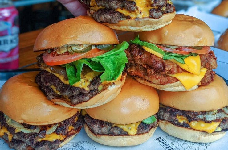 A stack of burgers from Burger Project, in Sydney.