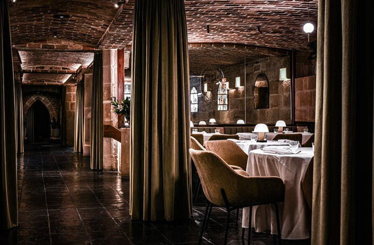The moody lamplit dining room at Beckett's.