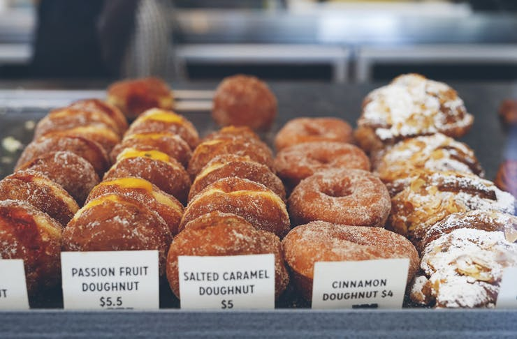 rows of doughnuts in a cabinet in Perth