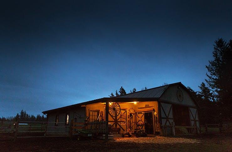 A farm hut under a night sky.