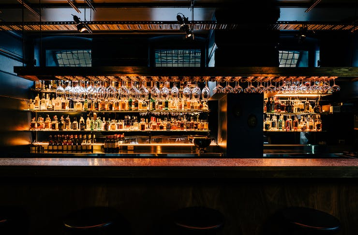 the gold lit bar inside Pooles Temple, a hidden underground bar in Perth's CBD