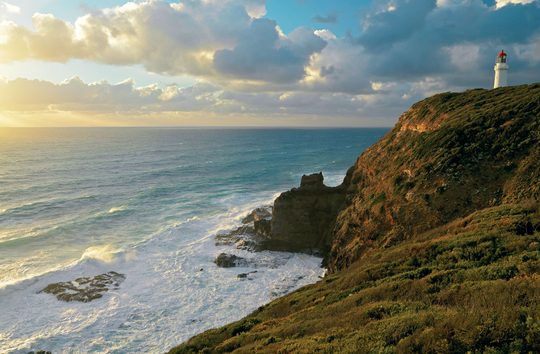 The Cape Schanck Lighthouse on Victoria's Mornington Peninsula. The sun is setting over Bass Strait.
