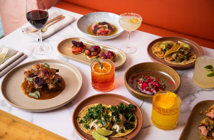 A table set with Mexican dishes and cocktails at Sinaloa in Sydney.