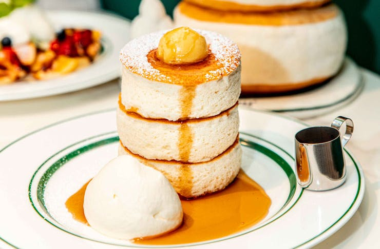 A three-tiered stack of Japanese souffle pancakes with ice cream from Gram in Sydney.