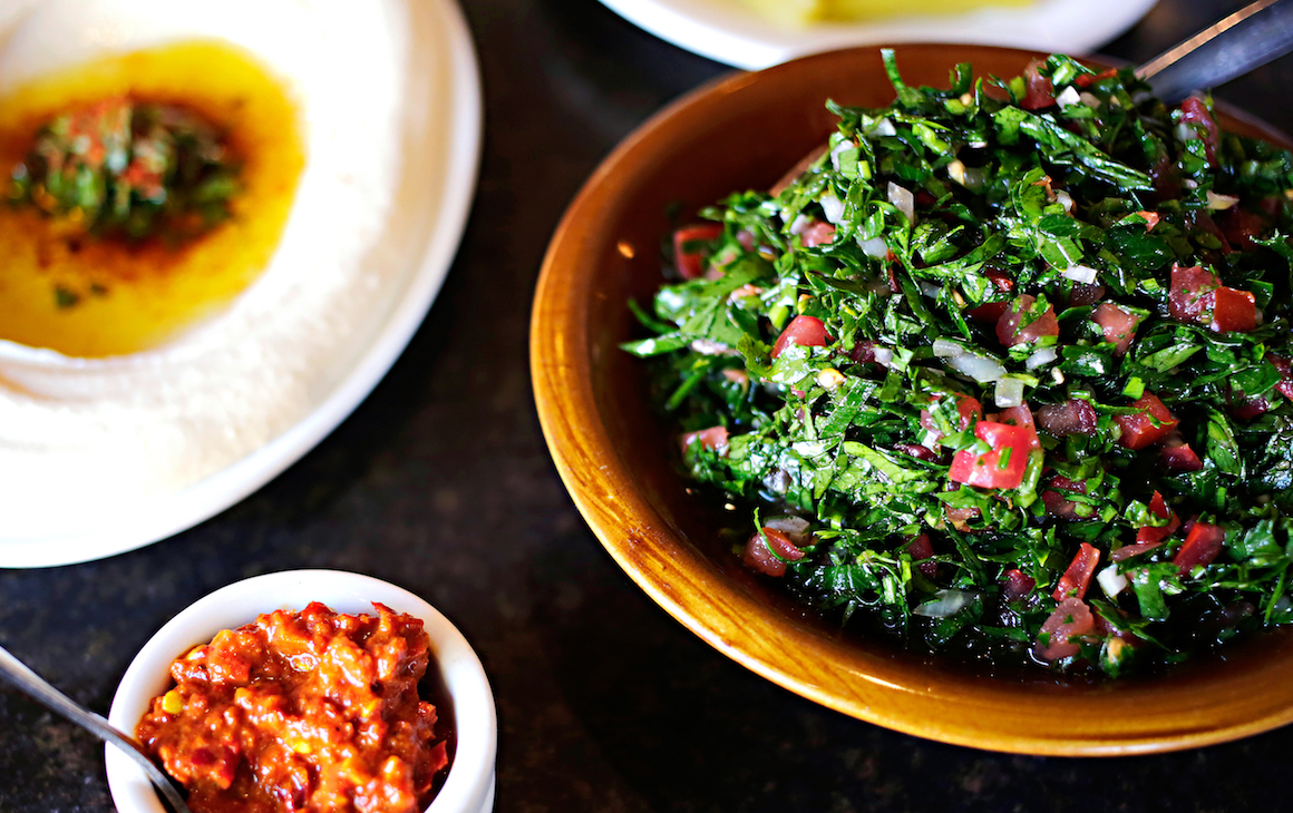 a bowl of tabouli and hummus