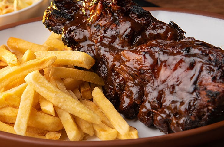 a close up of ribs and chips