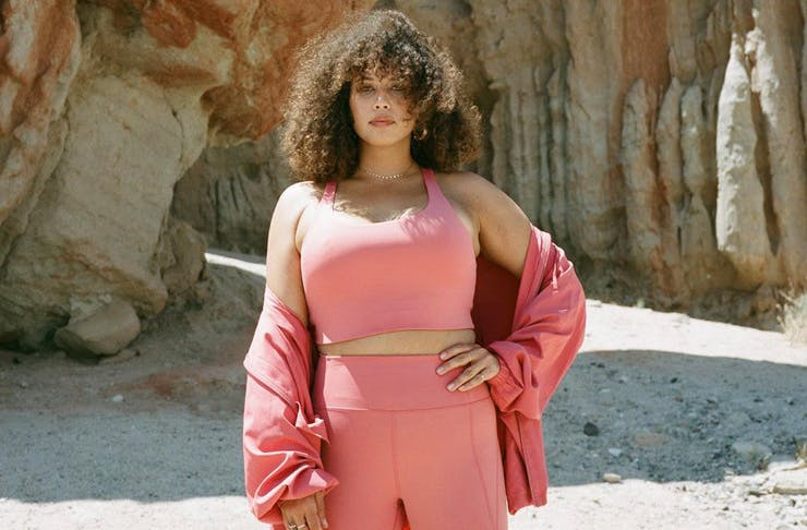 A model wearing a peach-coloured activewear set from sustainable label, Girlfriend.