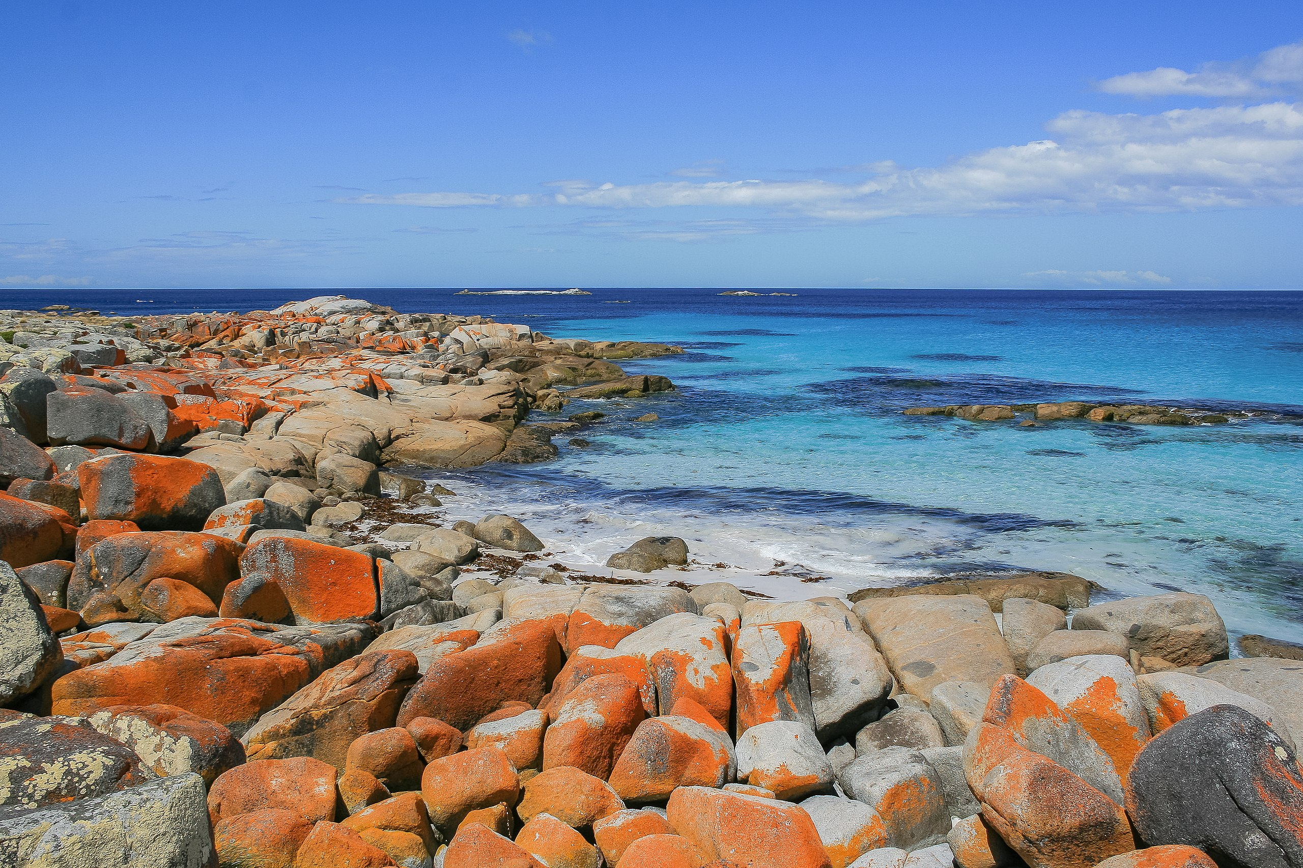 The stunning orange rocks at the Bay of Fires.