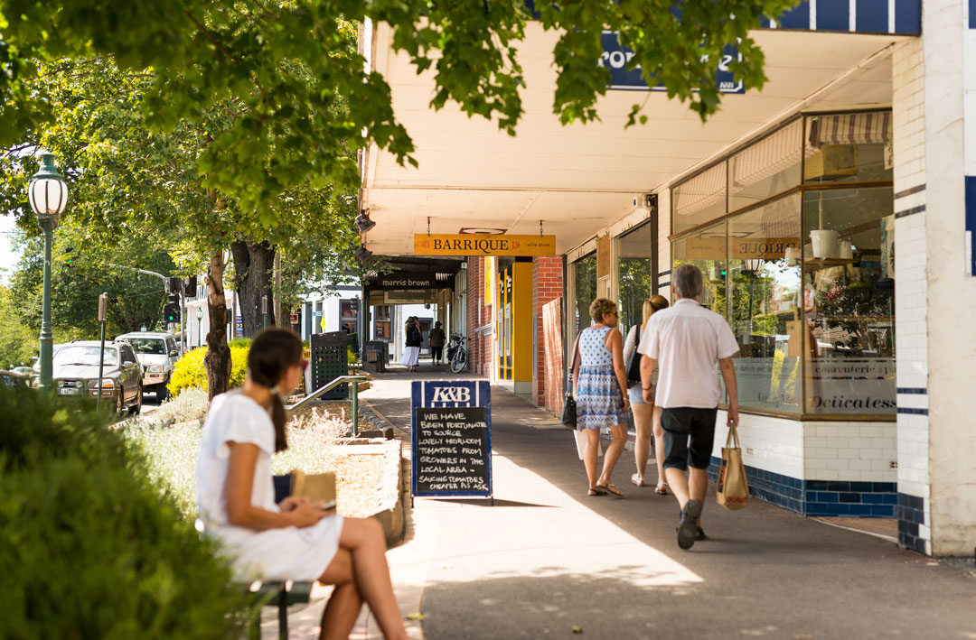 Healesville store Kitchen & Butcher with people walking past in the main street of Healesville, Victoria.