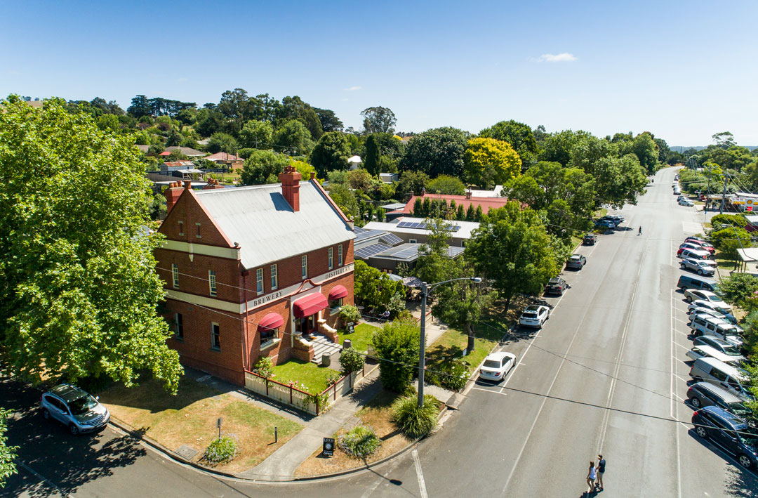 An aerial shot of Loch Distillery & Brewery along with the main street of Loch village in Victoria.