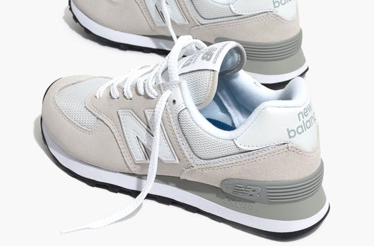 A pair of New Balance White 574 Core Sneakers.