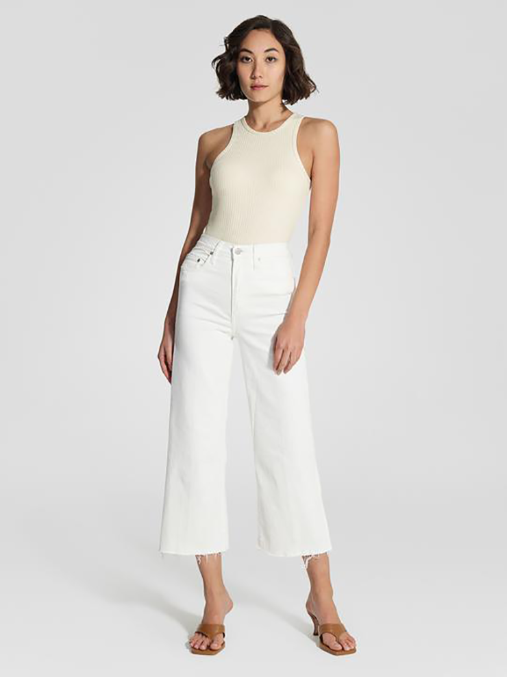 Some of the best wide leg jeans available for 2021, coloured white and sitting loosely on a model..