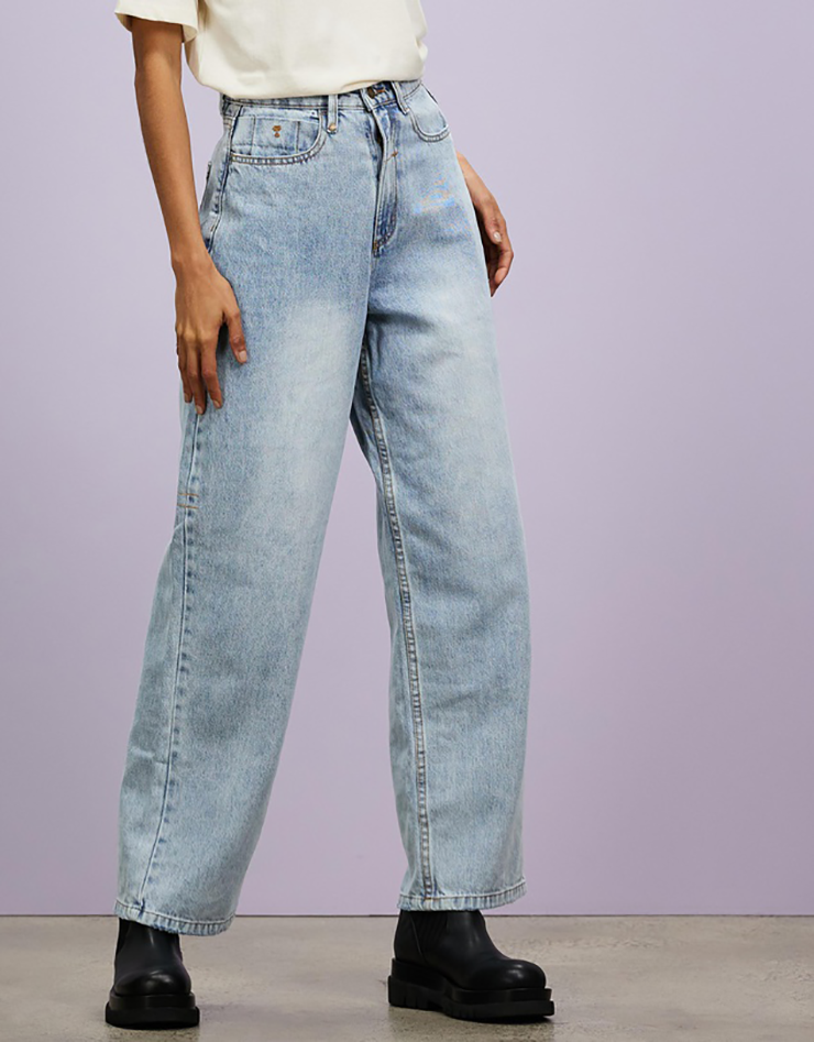 Some of the best wide leg jeans available for 2021, coloured blue grey and sitting loosely on a model..