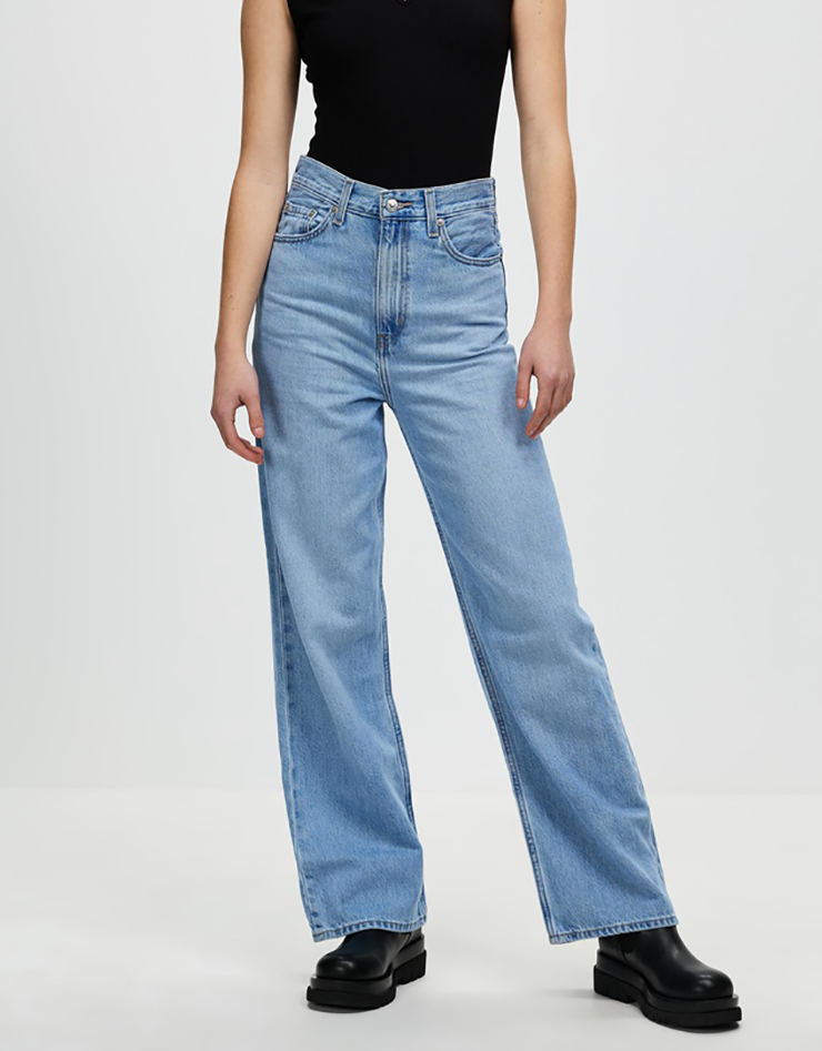 Some of the best wide leg jeans available for 2021, coloured light blue and sitting loosely on a model..