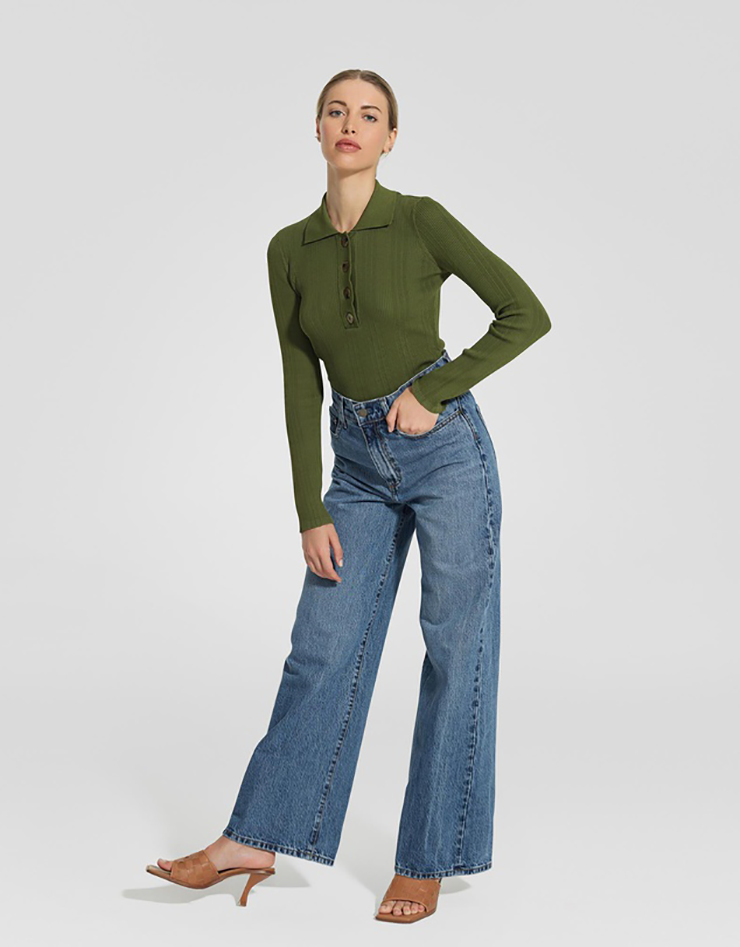 Some of the best wide leg jeans available for 2021, coloured medium blue and sitting loosely on a model..