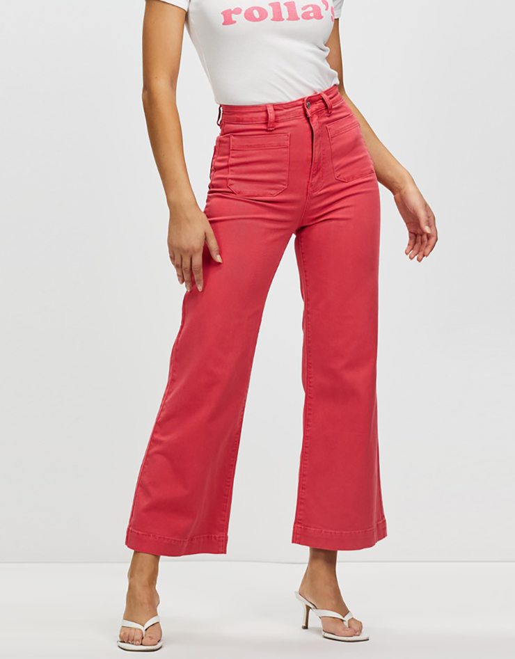 Some of the best wide leg jeans available for 2021, coloured light red.