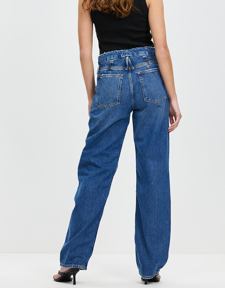 Some of the best wide leg jeans available for 2021, coloured indigo blue and sitting loosely on a model..