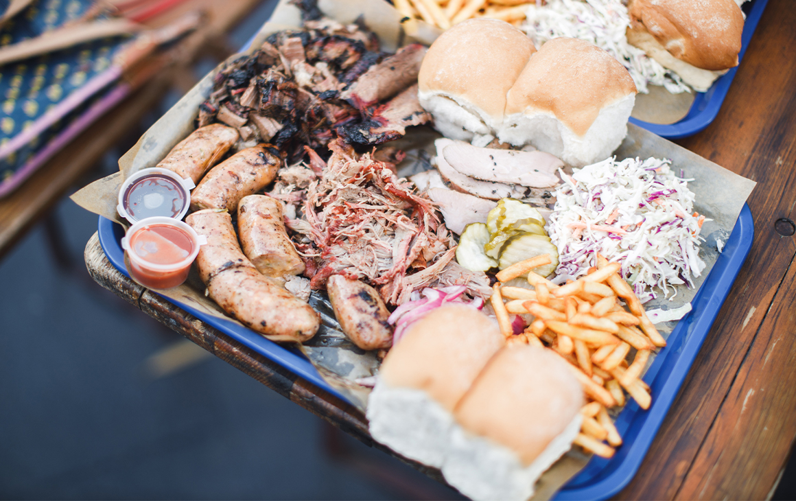 a platter of smoked meats and sides