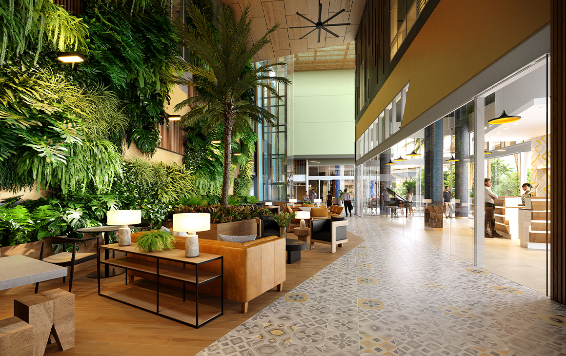 a plant covered hotel lobby