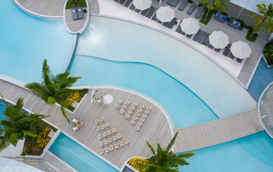 an aerial view of a resort pool