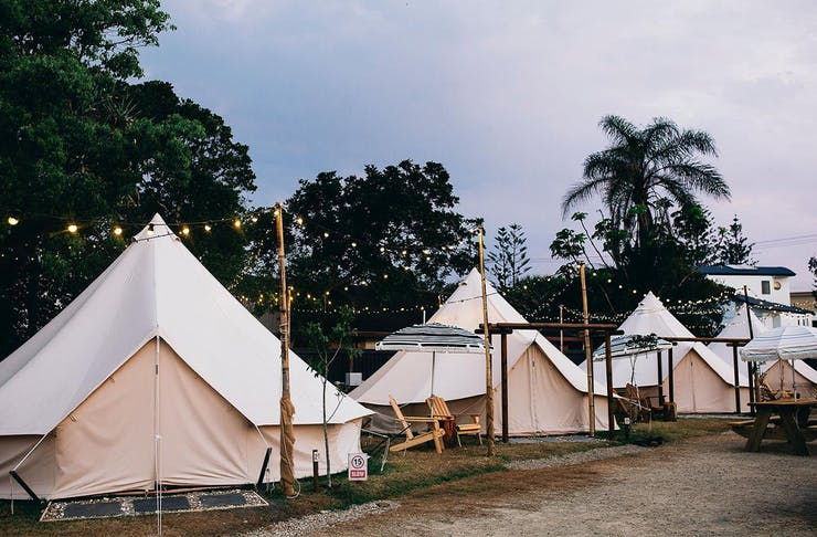 four canvas tents in a row