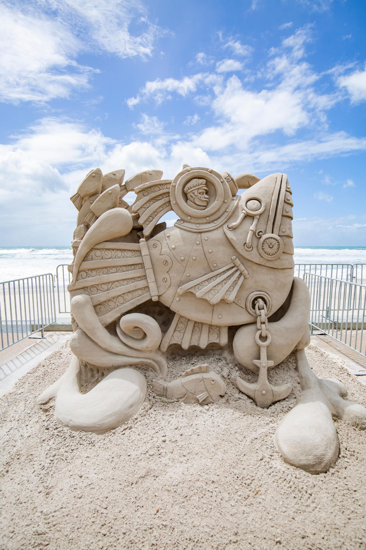 a sand sculpture of a fish