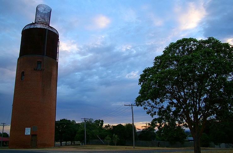 A large water tower that has been made to look like a wine bottle.