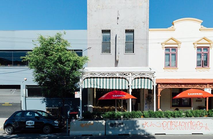 The facade of an Italian restaurant in Carlton on a sunny day.