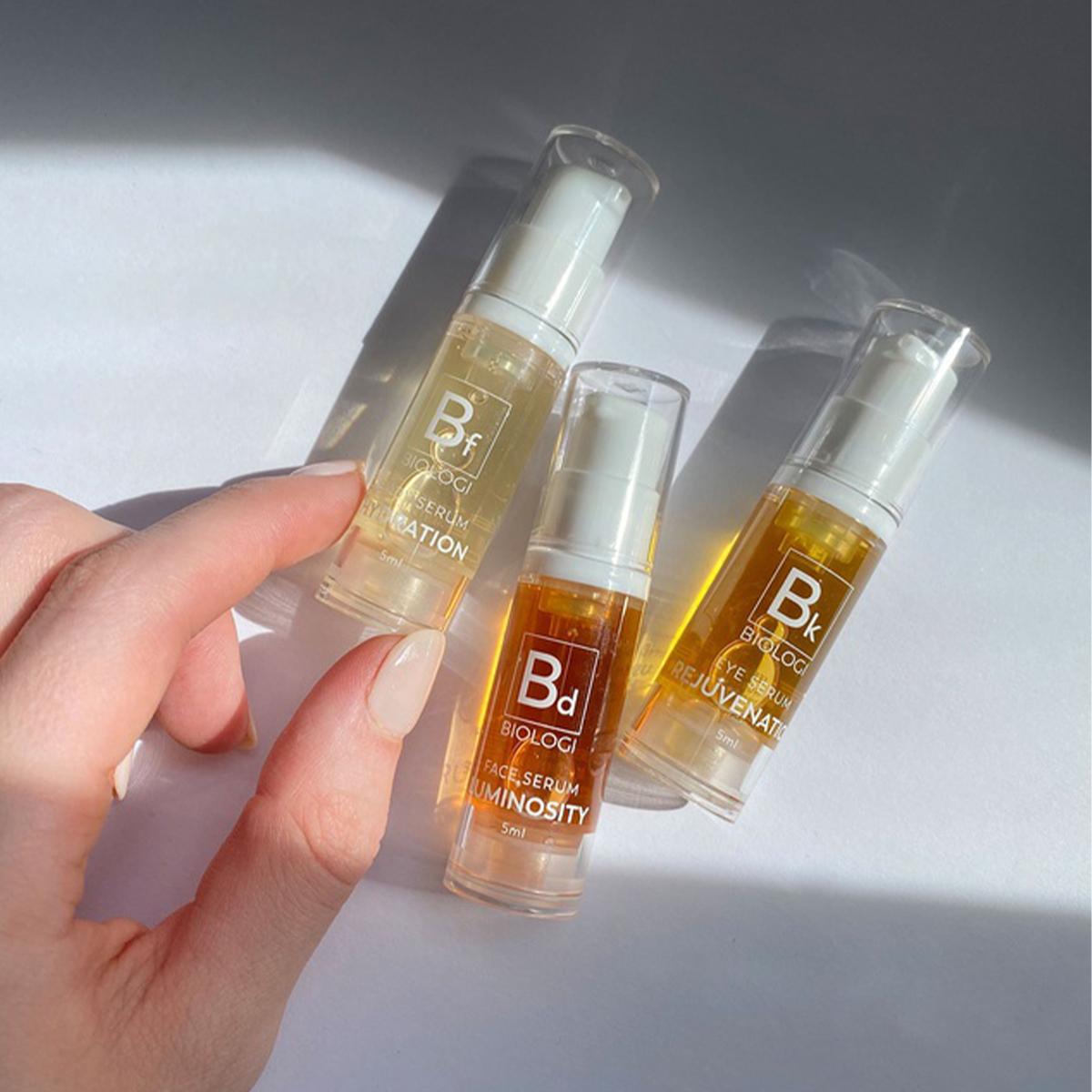 three mini biologi serum bottles