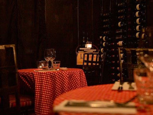 Red and white checked table cloths in the dining room at Bistro St Jacques.
