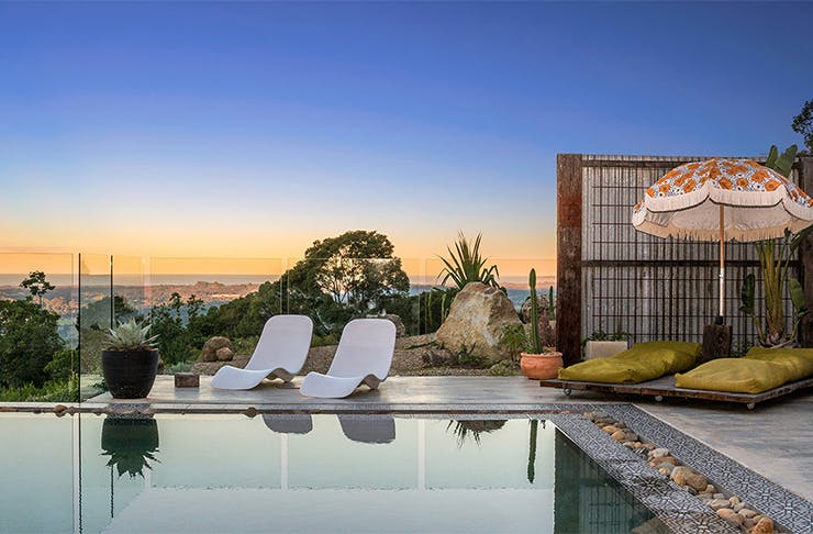 a pool with a stunning hinterland view