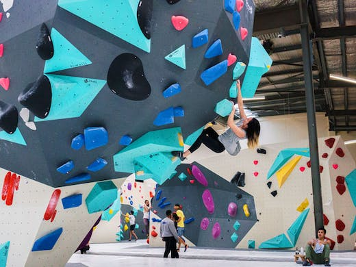 A woman climbing one of the bouldering walls at Blochause in Marrickville in Sydney.