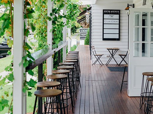 Front of Blockhouse Nundah, with greenery hanging over the front verandah.