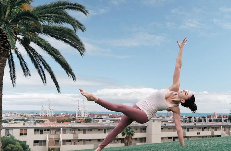 A yogi strikes a pose in a park