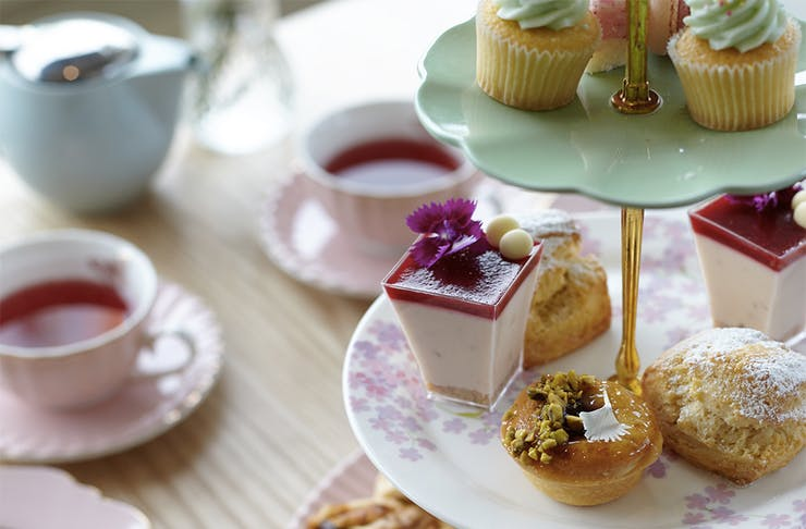 The high tea at Bluebells Cakery set out on delicate china.