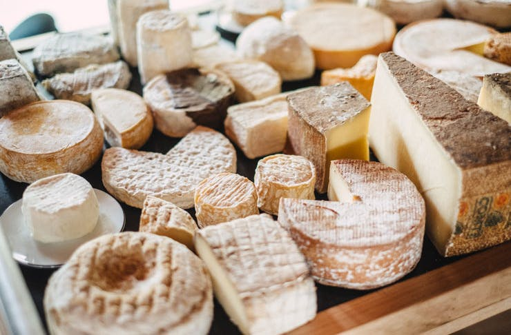 A table full of assorted cheeses.